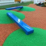 Blue balance boards set in rubber wetpour mounds