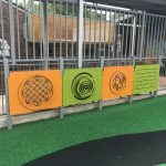 Brightly coloured sensory play panels with various activities for special needs children