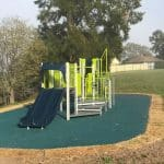 Children's school playground unit with double navy slide and bright Limon green panels