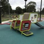 Smartplay Cube Playground unit for children aged 2 to 5 years of age in bright green and red with stainless steel slide