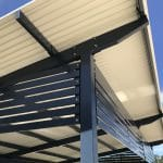 Skillion shelter roof with colorbond slat screen panels for extra protection against the sun