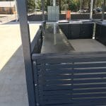 Shelter walls made with colorbond slat panels to protect bbq inside shelter area
