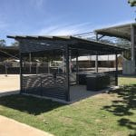Large skillion roof shelter over bbq area with side slat panels