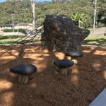 Mushroom steppers made out of GFRC concrete product made to look like timber set in bark mulch pit