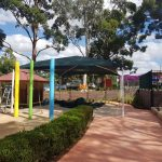 Hip Roof Shade Structure over children's sandpit area in child care centre yard