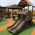 Playshaper Unit in pre school yard with treehouse roof and double slide