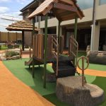Pre School playground unit with tree stump climber made from concrete to access playground