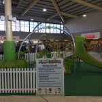 Indoor Shopping Centre play area for children with weevos unit featuring large arched frames and bright green slide