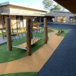 Custom Timber bridge in outdoor area with timber treads and cable hangers installed in synthetic grass