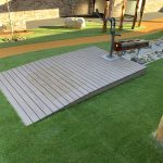 Mod Wood Timber Deck with ramp access to a water pump with timber log trough