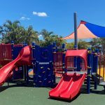 Childrens Playground unit with blue posts and panels and red slides