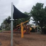 Green shade sail over a children's playground in a public park