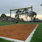 Swing Set with concrete border edge and bark mulch