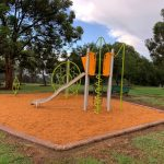 Playground Equipment with bright green spiral spinning climber