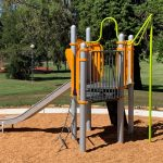 Playground with steel slide and green firemans pole