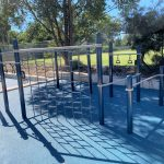 Outdoor Fitness Equipment with overhead monkey bars, parallel bars and climbing wall in continuous circuit