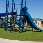 7 post net climber with high double slide on synthetic grass