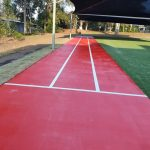 bright red painted concrete with white lines to create running track