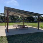 Park picnic skillion shelter on concrete slab with timber slats and trim