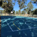 Blue Rubber Wetpour over basketball court with line marking for multi sport