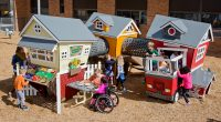 Childs cubby house play unit feature a market cafe, fire station and loft structure connected by tunnels