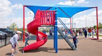 Spiral Red Slide with long ladder leading up to slide top