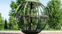 large spinning globe frame in bark with green sides and top
