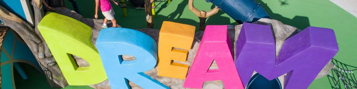 Large letters spelling out DREAM in multi colours