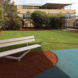 Courtesy Seat with rubber pathway green synthetic grass and bark mulch