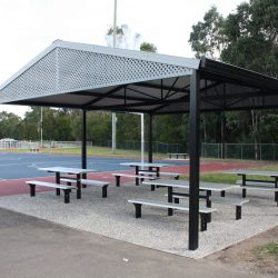 Metal shelter with gable roof and aluminium picnic table and benches under