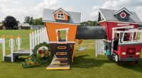 childs cubby house with fire station and house