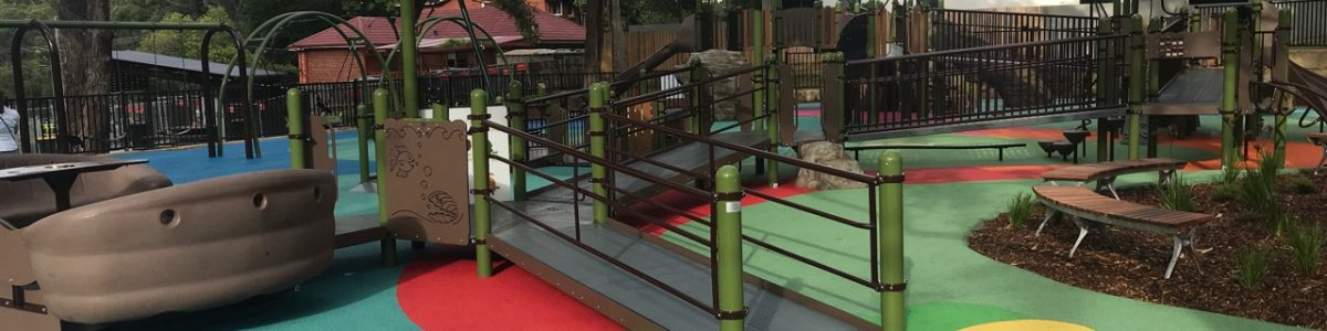 Inclusive Play area with ramps leading up to higher levels and Sway Fun Glider for wheelchairs