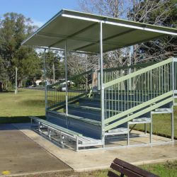 Spectator seating with skillion awning and pale eucalypt handrails