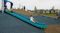 hill slide on rubber wetpour with rollers on bedway