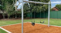 swing set with two support posts in bark mulch