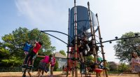 Tall tower structure with Cylinder shape with high double slide and ground level spinners and climbers